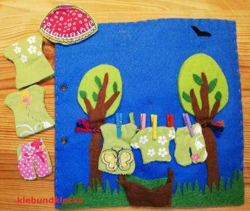 Wäsche aufgehängt an Wäscheleine zwischen Filzbäumen