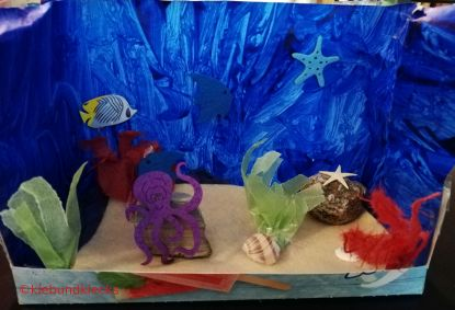 Aquarium gestaltet mit Fischen, Seesternen,...