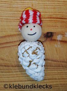 Winterkind aus Zapfen und Kugel